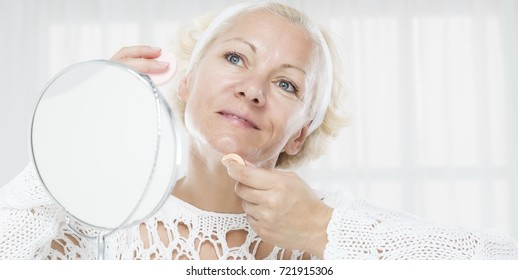 Woman face care and mirror