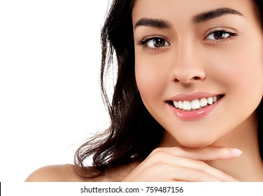 Woman face closeup portrait beautiful beauty model girl with beautiful smile teeth and hand. Studio shot.
