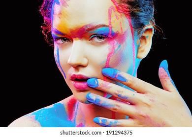 Woman face with colorful  bodyart