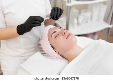 Woman face cosmetology treatment. Biorevitalization skin therapy. Injecting in medical salon. The procedure of biorevitalization in the area of eyes with a preparation with hyaluronic acid