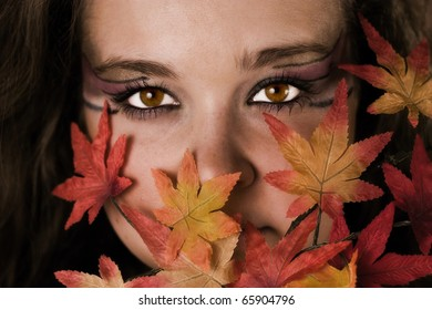Woman face hidden behind the leaves