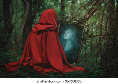 Woman face in a magical mirror. Dark fantasy and surreal