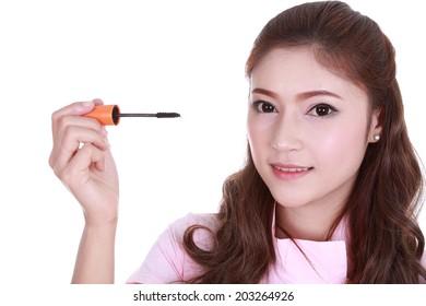 woman face with mascara brush isolated on white background