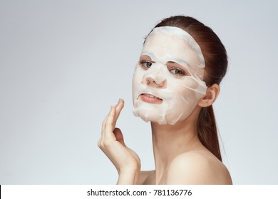 woman in a face mask, skin care, cleanliness