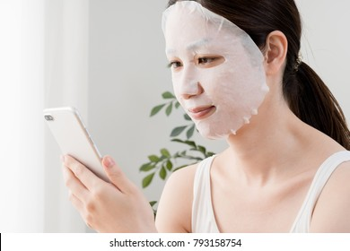 Woman with face mask, smartphone