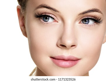 Woman face with natural makeup isolated on white beauty concept with healthy skin