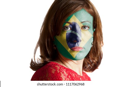 Woman face with painted Flag of Brazil isolated on white background
