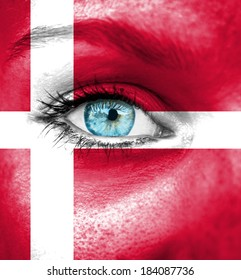Woman face painted with flag of Denmark