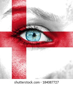 Woman face painted with flag of England