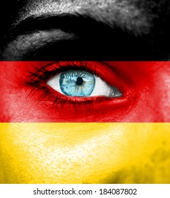 Woman face painted with flag of Germany