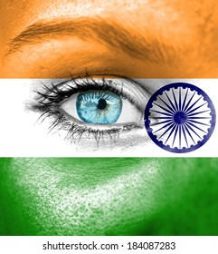 Woman face painted with flag of India