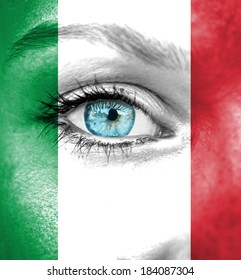 Woman face painted with flag of Italy