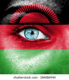 Woman face painted with flag of Malawi