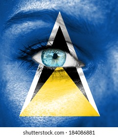 Woman face painted with flag of Saint Lucia