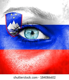 Woman face painted with flag of Slovenia