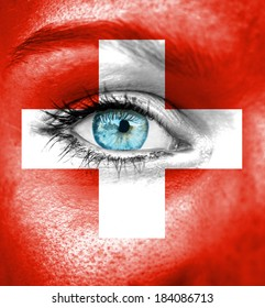 Woman face painted with flag of Swiss