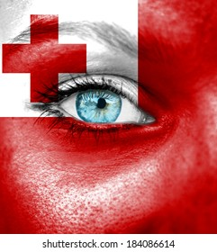 Woman face painted with flag of Tonga