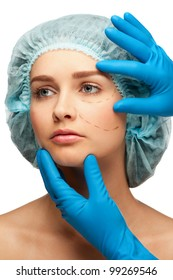 Woman face with perforation lines before plastic surgery operation. Isolated on white background