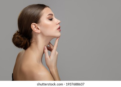 Woman face profile side view. Chin lift pointing with index finger