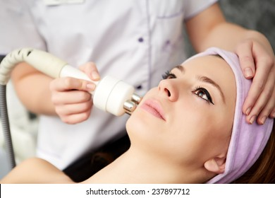 woman face treatment in medical spa center