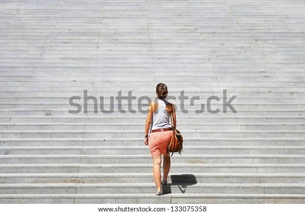 Woman facing a challenge.