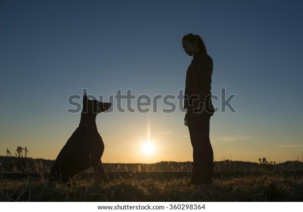 Woman facing the Doberman