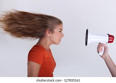 Woman facing megaphone