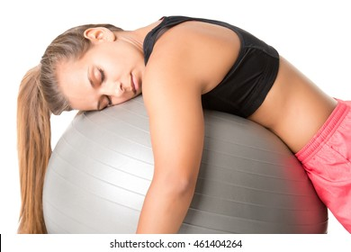 Woman falling asleep in the gym, isolated in white
