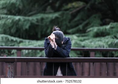Woman falling down by handrail