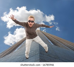 a woman falling off of a tall building