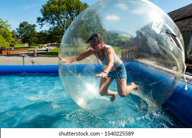 A woman falls in a zorb ball