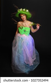 woman in a fantastic costume of a spring fairy