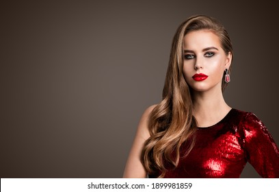 Woman Fashion Beauty Face Portrait. Model Makeup with Red Lips, long wavy Hair Style. Red Sparkling Evening Dress