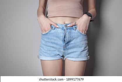 Woman in fashion blue jeans shorts.