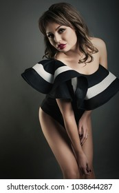 woman fashion body shot in studio bg