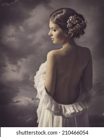Woman fashion dress, retro hair style, elegant girl in gown with naked back, historical romance portrait