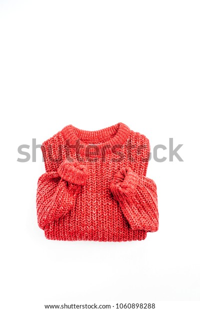 Woman fashion flat lay, top view concept. Red sweater cloth.