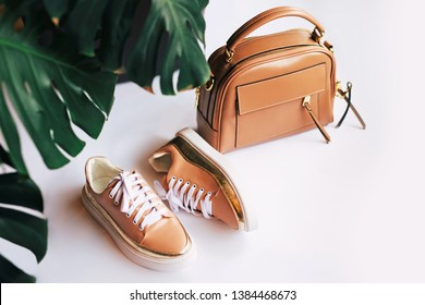 Woman fashion, matching color, casual summer boots and handbag set, on a white background.