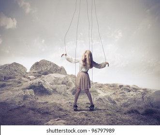 Woman fastened to ropes as a puppet