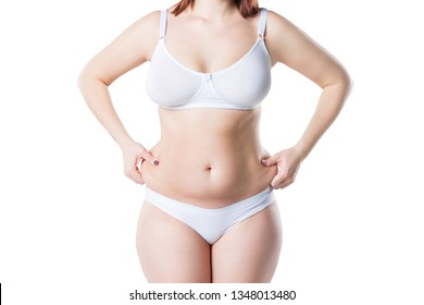 Woman with fat belly, overweight female body isolated on white background, studio shot