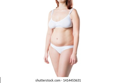 Woman with fat flabby belly, overweight female body isolated on white studio background