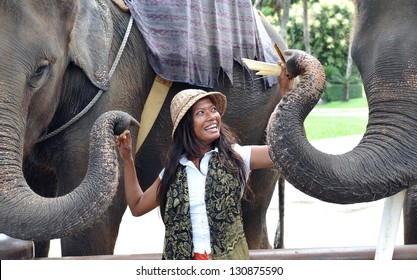 Woman feeding the elephants