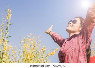 a woman feeling happily in the flower garden.woman smiling with happiness in the flower garden.