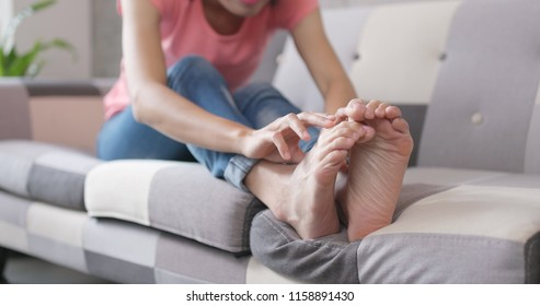 Woman feeling itchy on her feet