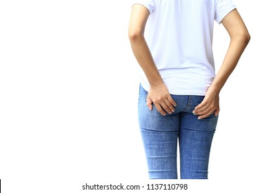 Woman feeling pain the butt and has diarrhea or hemorrhoids holding her butt on white background, Healthy concept