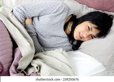 Woman feeling sick in bedroom