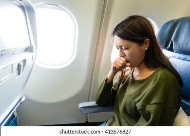 Woman feeling sick inside air plane