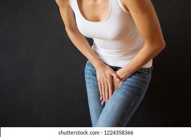 Woman feeling sick, needs to pee