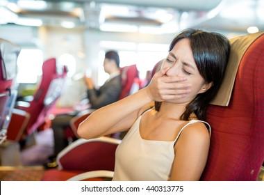 Woman feeling sick on boat