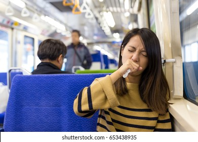 Woman feeling sick in train compartment